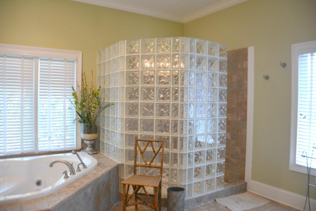 Master Bath with whirlpool bath and glass enclosed shower stall