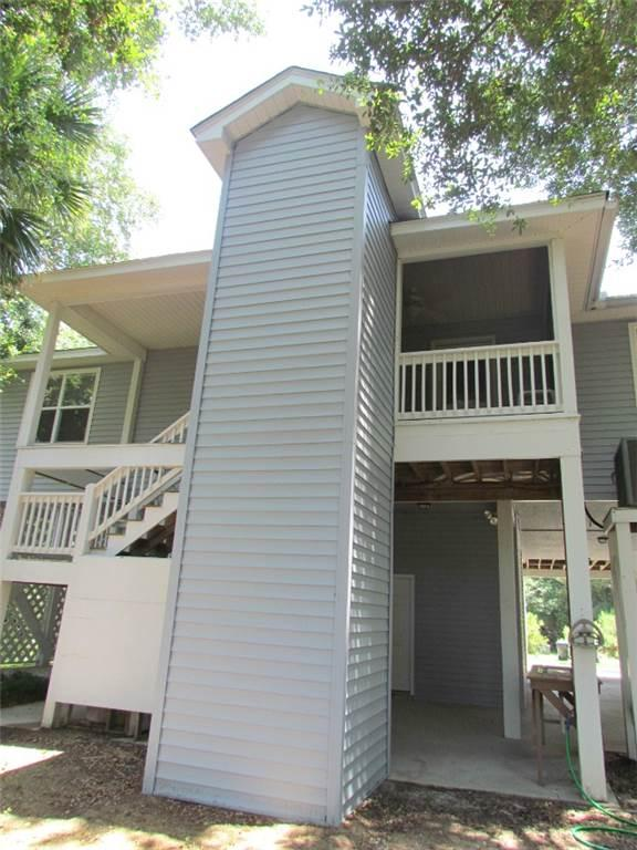 Rear view of house with screen porch and elevator access