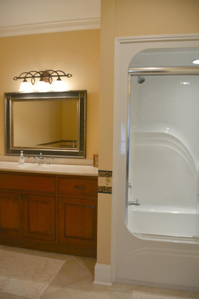 Hall bath for BR 1 & BR 2 - tub shower & small refrigerator